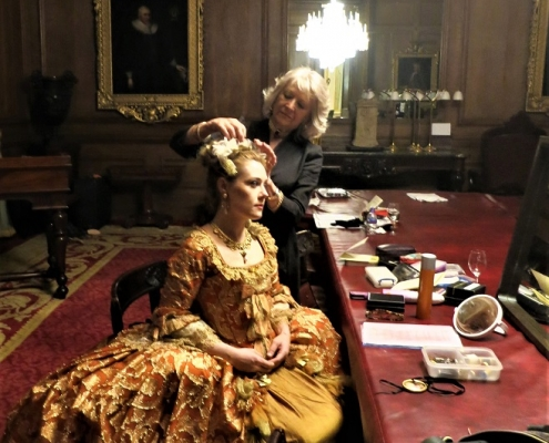 Wardrobe mistress attends to Dorabella's hair in our magnificent dressing room at The Goldsmiths' Hall