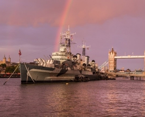 HMS Belfast sits regally on the Thames by Tower Bridge